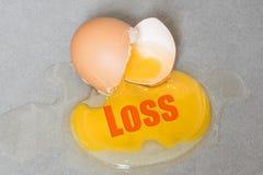 Bad wording on Egg drop crack splattered down on ceramic tile. Stock Images