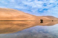 Badain Jaran Desert and lake stock images