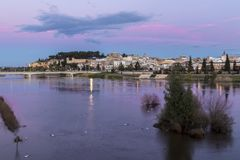 Badajoz, Spain. Views at sunset of river Guadiana and the Old Town, from the Puente de Palmas bridge Royalty Free Stock Photo