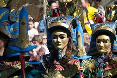 Egyptian masks. Badajoz, Spain - March 2, 2019: Performers with costumes inspired in egypt fantasy take part in the Carnival parade of comparsas at Badajoz City royalty free stock photo