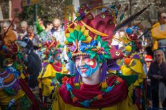 Smile in Carnival. Badajoz, Spain - March 2, 2019: Performers with costumes inspired in fantasy take part in the Carnival parade of comparsas at Badajoz City, on royalty free stock photo