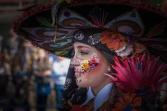 Mexico in Carnival. Badajoz, Spain - March 2, 2019: Performers with costumes inspired in Mexico take part in the Carnival parade of comparsas at Badajoz City, on stock photos