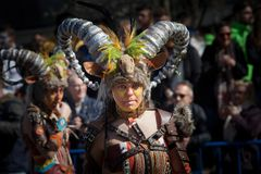 Rams in Carnival. Badajoz, Spain - March 2, 2019: Performers with costumes inspired in rams take part in the Carnival parade of comparsas at Badajoz City, on royalty free stock images
