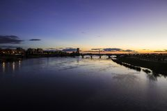 Badajoz, Spain. Views at sunset of river Guadiana and the Puente Real Royal Bridge, from the Puente de Palmas bridge Stock Photo