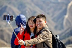 BADALING, CHINA - MARCH 13, 2016: Great Wall of China. Young co. Uple make selfie on the background of the Great Wall of China stock image
