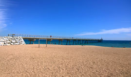 Badalona beach and Pont del Petroli, Spain Stock Photos