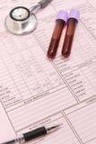 Badanie krwi stetoskop z piórem i tubka Fotografia Royalty Free