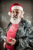 Badass mal-humorados Santa Claus Fotos de Stock Royalty Free