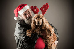 Badass Santa with dog. As rudolph the reindeer royalty free stock photos
