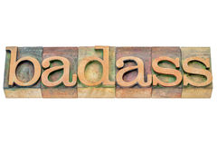 Badass word abstract. Badass - isolated word abstract in letterpress wood type printing blocks stained by color inks stock photo