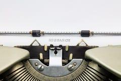 Badawczy słowo w kapitałowych listach na bielu prześcieradle obrazy royalty free