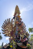 Bade cremation tower with traditional balinese sculptures of demons and flowers on central street in Ubud, Island Bali, Indonesia. Prepared for an upcoming stock image