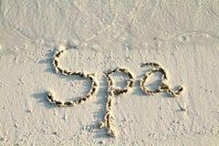 ?Badekurort? geschrieben in Sand. Stockfoto