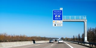 Autobahn signage Rasthof Renchtal. BADEN WURTTEMBERG, GERMANY - FEB 25, 2018:Driver point of view at the upfront driving cars and signage sign to the next gas Royalty Free Stock Photo
