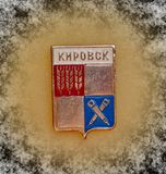 Badge with the coat of arms of the city of Kirovsk, Murmansk region from the series `cities of the USSR`. Closeup. Faleristics. Heraldry stock photo