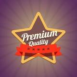 Badge con la stella ed il marchio di qualità di premio su buio Fotografia Stock