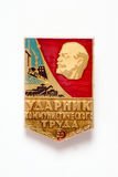 Badge depicting the head of Lenin and the inscription. Metal badge depicting the head of Lenin and the inscription `Drummer Communist labor royalty free stock photo