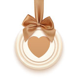 Badge with heart, golden ribbon and a bow Royalty Free Stock Photography