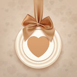 Badge with heart, golden ribbon and a bow Royalty Free Stock Images