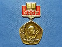 Badge with the image of Vladimir Lenin Ulyanov from the series `Vladimir Lenin`. Closeup. Faleristics. Low DOF photography royalty free stock photos