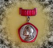 Badge with the image of Vladimir Lenin Ulyanov from the series `Vladimir Lenin`. Closeup. Faleristics. Low DOF photography royalty free stock images