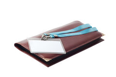 Badge on leather business card holder Stock Images