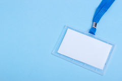 Badge with neckstrap. Blank business plastic badge with blue neck strap and selective focus copy space Stock Images
