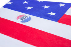 Badge put on American flag. On white background Royalty Free Stock Photo
