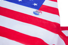 Badge put on American flag. On white background Stock Images