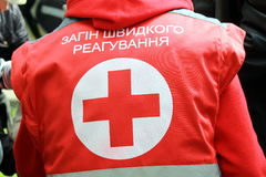 Badge of the Red Cross on the uniform of medical personnel. Badge of the Red Cross on the uniform of medical personnel and the inscription Rapid reaction unit stock image