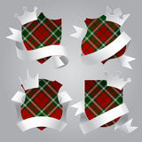Badge set with tartan background, white paper ribbons and crowns Stock Image