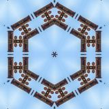 Badge shape with metal barrels and pipes in sky. Geometric kaleidoscope pattern on mirrored axis of symmetry reflection. Colorful shapes as a wallpaper for stock photos