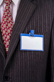 Badge on a suit. Blank badge blue plastic on a business suit manager Stock Image
