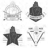 Badge, symbol or logotype with hand. Stock Image