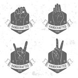 Badge, symbol or logotype with hand. Stock Photography