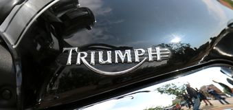 Badge of Triumph motorcycle at Yearly Mass Ride Royalty Free Stock Photos