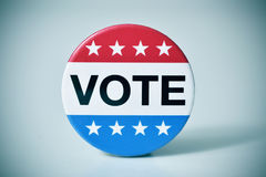 Badge for the United States election. Closeup of a badge with the word vote written in it, for the United States election, with a slight vignette added Royalty Free Stock Image
