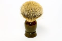 Badger fur shaving brush. A closeup view of a genuine badger fur shaving brush with a brown plastic handle, isolated on white Stock Photography