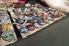 The badges are on the fair table