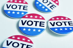 Badges for the United States election. Some badges with the word vote written in it, for the United States election, with a slight vignette added Stock Photo