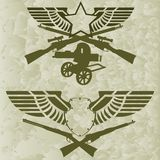 Badges with wings and firearms Royalty Free Stock Images