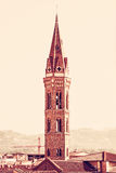 Badia Fiorentina steeple in Florence, Italy, red filter Stock Photos