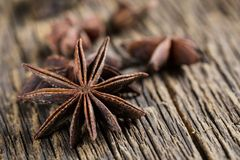 Badian, anise close-up. Badian or anise star on a wooden background stock photography