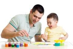 Badinez la peinture de garçon et de papa ensemble d'isolement sur le blanc photographie stock libre de droits