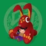 Badinez les amours jouant avec l'animal chinois de zodiaque - lapin Photographie stock
