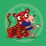 Badinez les amours jouant avec l'animal chinois de zodiaque - tigre Photo libre de droits