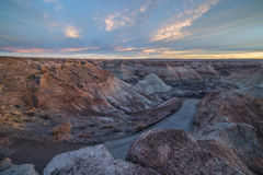 Badland Formations, Petrified Wood, and Bentonite Clay Near Blue Mesa Trail During Beautiful Sunset in Petrified Forest. Petrified Forest National Park is a Royalty Free Stock Photography
