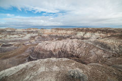 Badland Formations, Petrified Wood, and Bentonite Clay Near Blue Mesa Trail in Petrified Forest National Park, Arizona. Petrified Forest National Park is a Royalty Free Stock Photo