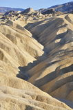 Badland formations, Zabriskie Point, Death Valley. Badland formations of Zabriskie Point in Portrait mode Royalty Free Stock Image