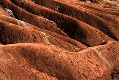 Badlands. A badlands  (also badland)  is a type of dry terrain where softer sedimentary rocks and clay-rich soils have been extensively eroded by wind and water Royalty Free Stock Photo